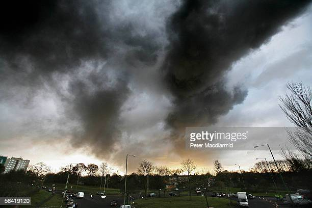 Smoke fills the sky as fire continues to burn at the Buncefield oil depot on December 12 2005 in Hemel Hempstead England Fire officers continue to...