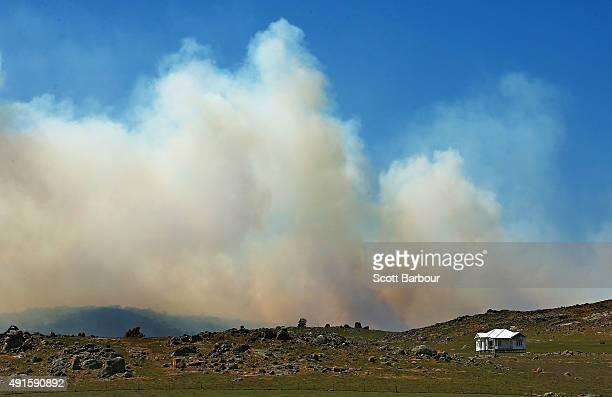 Smoke form a bushfire is seen near a property near Benloch Victoria on October 7 2015 near Melbourne Australia Victorian fire crews have been...
