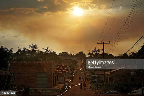 Smoke from a brush fire hovers above a deforested section of the Amazon basin on November 21 2014 in Maranhao state Brazil Fires are often set by...