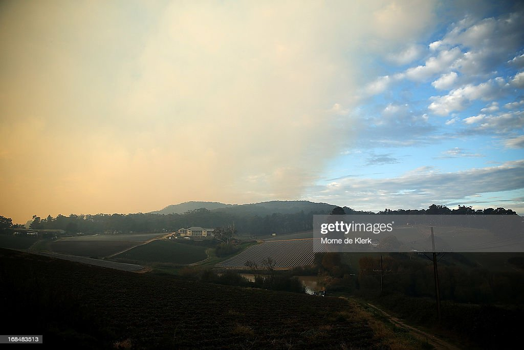 Smoke from a bushfire that is burning out of control at nearby Cherryville, hangs over the Adelaide Hills on May 10, 2013 in Adelaide, Australia. The out of control bushfire has burned 250 hectares (617 acres) of rugged terrain in the Adelaide Hills, claiming one house, and threatening more property.
