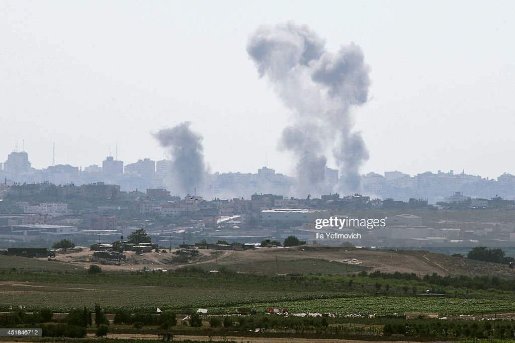 Smoke from an Israeli air strike rises over the Gaza Strip on July 8, 2014, in Sderot, Israel. Due to recent escalation in the region, the Israeli army has started new deployments at the border with Gaza. In the past 3 weeks more than 130 rockets where reportedly fired from Gaza into Israel.