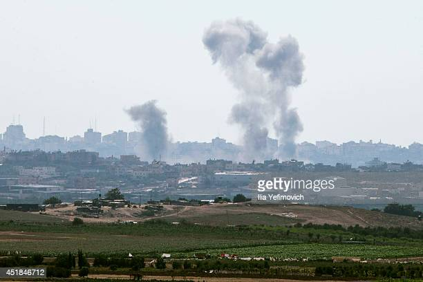 Smoke from an Israeli air strike rises over the Gaza Strip on July 8 in Sderot Israel Due to recent escalation in the region the Israeli army has...