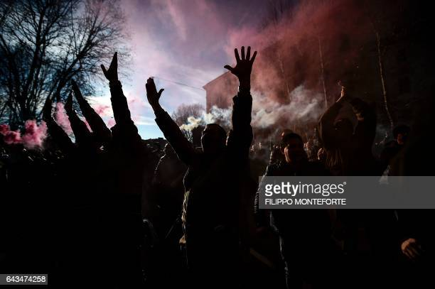 Smoke from flares rises above taxi drivers demonstrating in front of the Infrastructure and Transportation Ministry in Rome to protest against the...