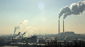 Pollution. Smoke from industrial chimneys against the blue sky