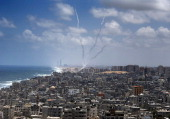 Smoke from rockets fired from Gaza City are seen after being launched toward Israel on July 15 2014 US Secretary of State John Kerry warned of the...