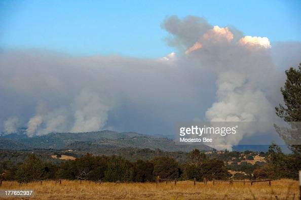 Smoke from the Rim Fire billows into the atmosphere as it burns the hillsides of the Stanislaus National Forest south east of Sonora California...