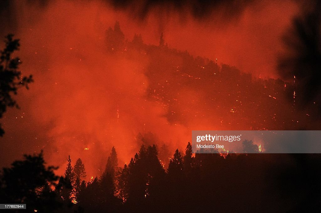 Smoke from the Rim Fire glows orange while a hillside smolders in a canyon of the South Fork in Tuolumne County California in the Stanislaus National...