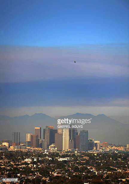 Smoke from the wildfire and pollution rise over downtown Los Angeles on September 5 2009 Overnight containment of the 154000acre blaze the largest in...