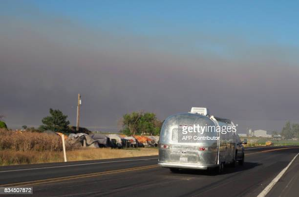Smoke from wildfires darkens the sky as an Airstream trailer arrives in Madras Oregon on August 17 ahead of the total solar eclipse on August 21 The...