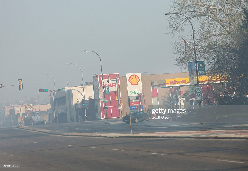 Smoke from wildfires fill the morning air near a gas station on May 6, 2016 in Fort McMurray, Alberta, Canada. Wildfires, which are still burning out of control, have forced the evacuation of more than 80,000 residents from the town.