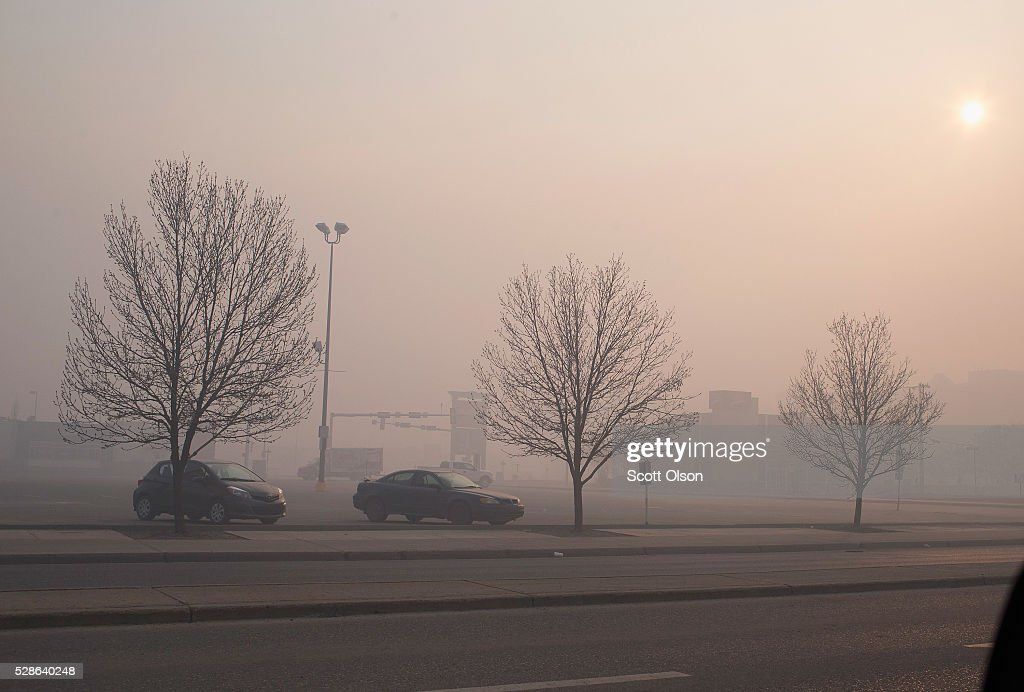 Smoke from wildfires fill the morning air on May 6, 2016 in Fort McMurray, Alberta, Canada. Wildfires, which are still burning out of control, have forced the evacuation of more than 80,000 residents from the town.