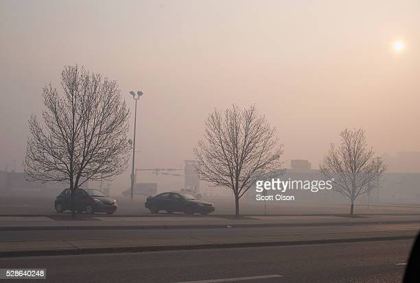 Smoke from wildfires fill the morning air on May 6 2016 in Fort McMurray Alberta Canada Wildfires which are still burning out of control have forced...