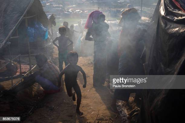 Smoke is in the air as dinner is cooking inside of tents September 25 2017 in Thainkhali Cox's Bazar Bangladesh Over 429000 Rohingya refugees have...