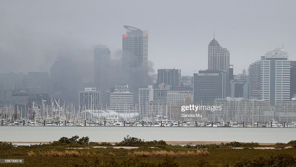 Smoke is seen from an apartment fire in the CBD during the Ironman 70.3 Auckland triathlon on January 20, 2013 in Auckland, New Zealand.
