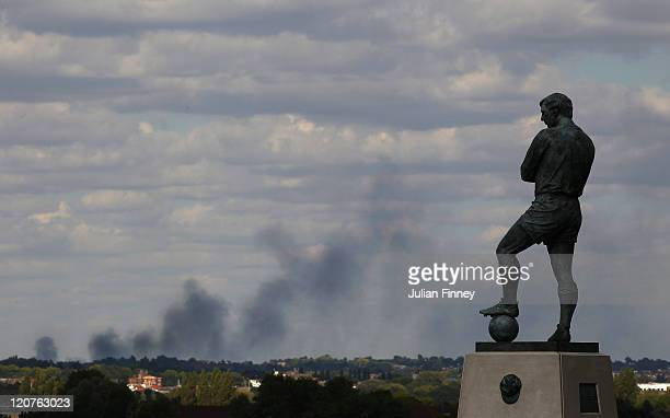 Smoke is seen over north London from a view behind the Bobby Moore statue outside Wembley Stadium as the England v Netherlands game is called off at...
