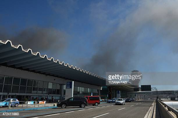 Smoke is seen over Rome's Fiumicino international airport where a fire broke out overnight on May 7 2015 No serious injuries were reported as a...