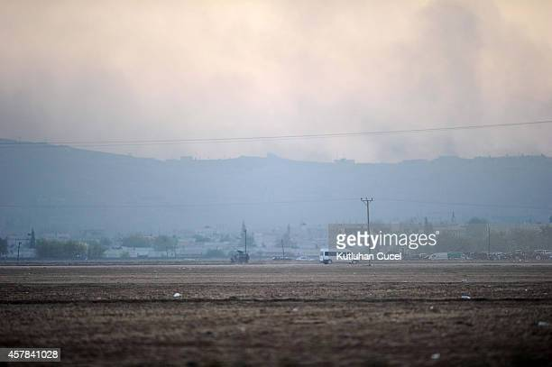 Smoke is seen over Syrian town of Kobani following the clashes between Islamic State militants and Kurdish People's Protection Unit fighters October...