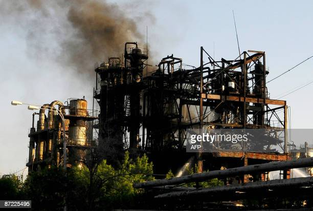 Smoke is seen rising from rectifying columns at the Nairit plant in Yerevan on May 14 2009 A fire at a synthetic rubber plant in the Armenian capital...