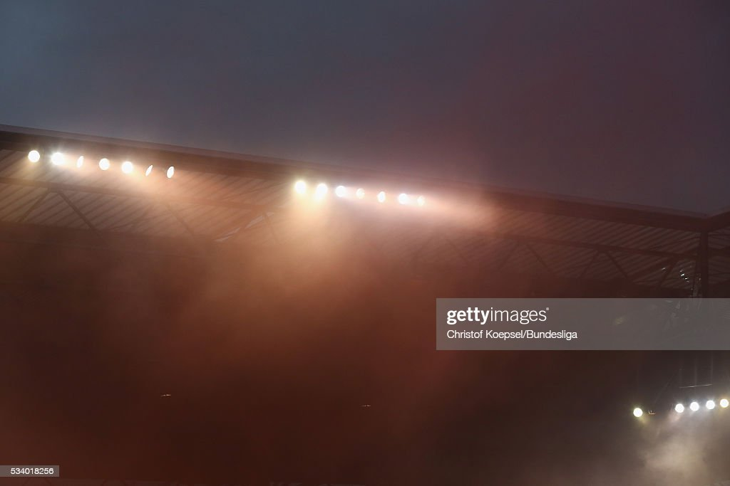 Smoke of Fire bombs are seen during the Second Bundesliga play-off second leg match between MSV Duisburg and Wuerzburger Kickers at Schauinsland-Reisen-Arena on May 24, 2016 in Duisburg, Germany. The match between Duisburg and Wuerzburg ended 1-2.