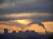 Industrial buildings at sunset sky