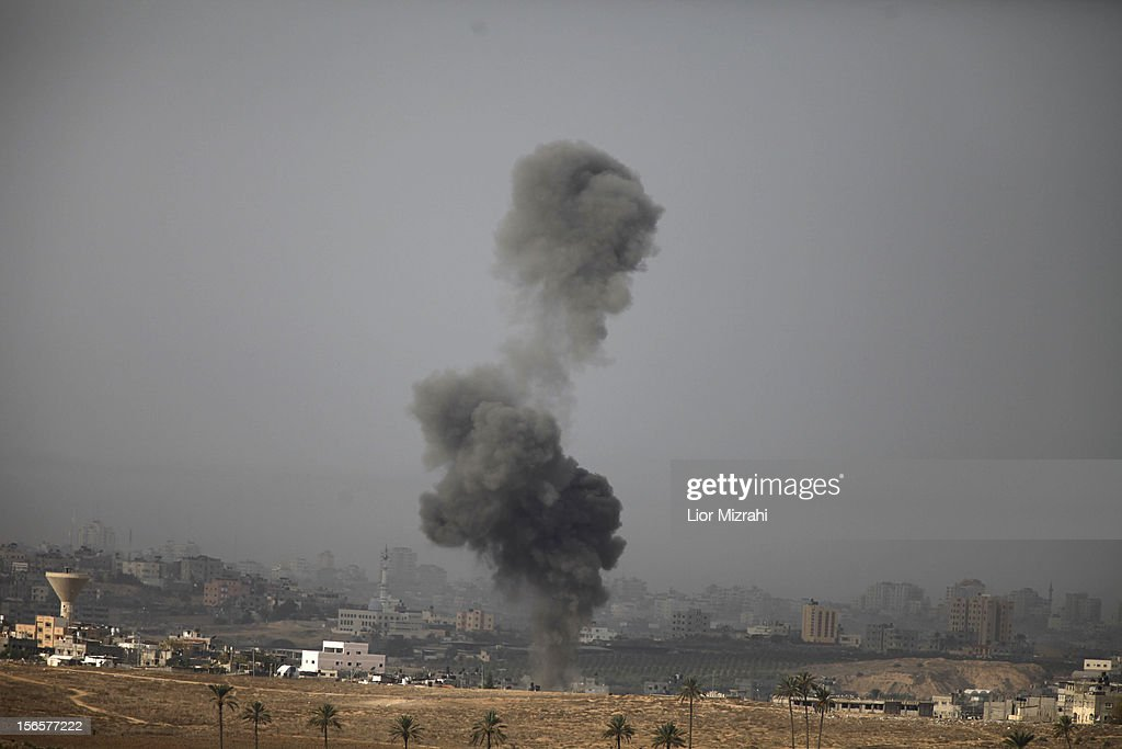 A smoke plumes rises over Gaza following an Israel Air Force bombing, as seen from near Sderot on November 17, 2012 in Israel. At least 39 Palestinians and three Isreali's have died since conflict began four days ago. Israeli troops have been massing on the border as some 200 targets were hit overnight in Gaza, including Hamas cabinet buildings.
