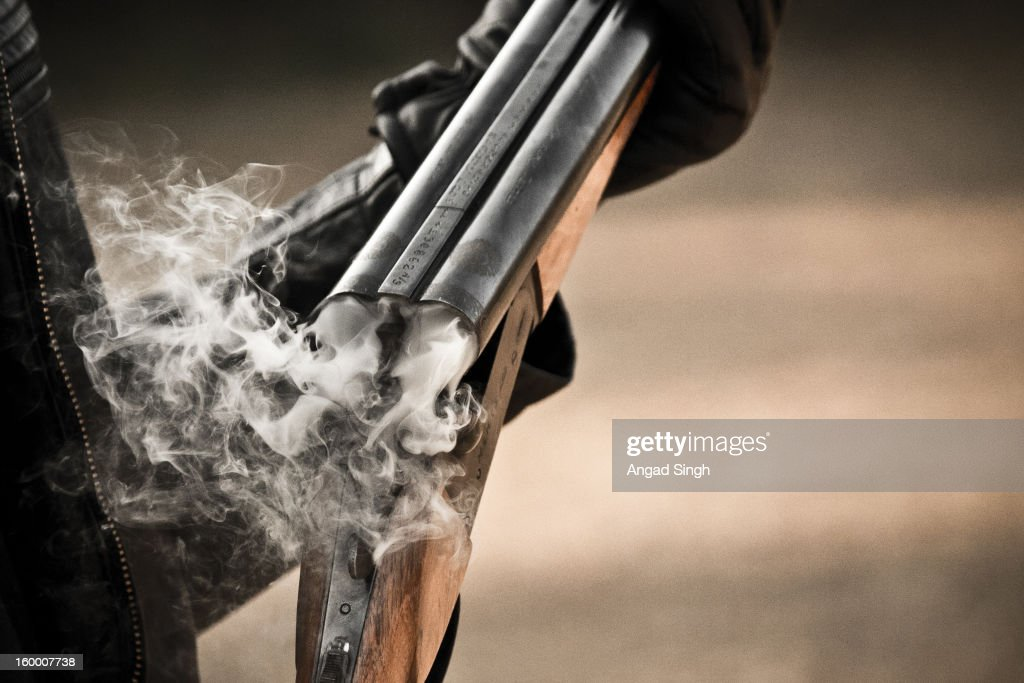 CONTENT] Smoke pours from the breech of a recently fired shotgun.