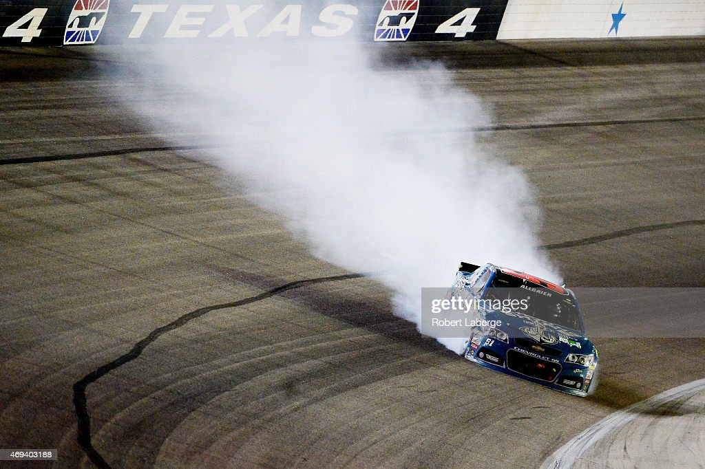 Smoke pours from the Flipping Ships Chevrolet driven by Justin Allgaier after hitting the wall during the NASCAR Sprint Cup Series Duck Commander 500...