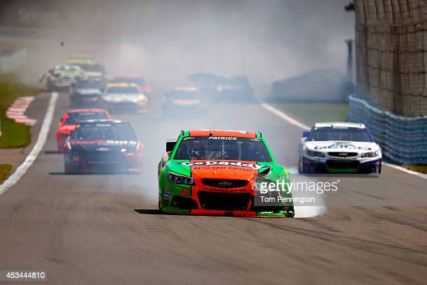 Smoke pours from the GoDaddy Chevrolet driven by Danica Patrick after an ontrack incident during the NASCAR Sprint Cup Series CheezIt 355 at Watkins...