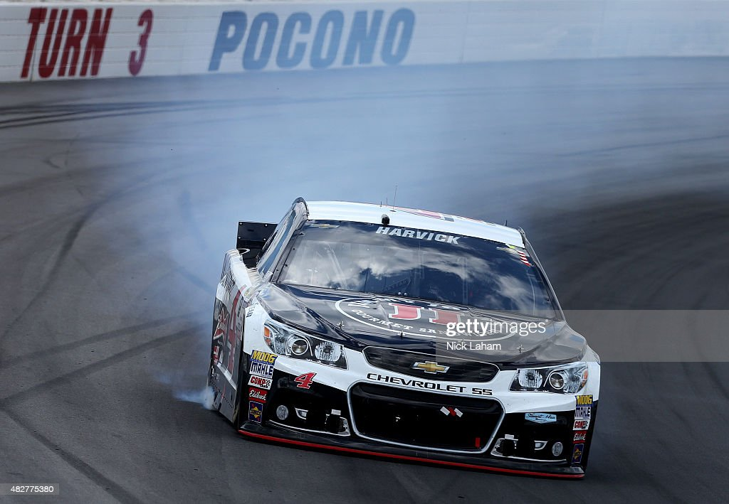 Smoke pours from the Kevin Harvick driver of the Jimmy John's/Budweiser Chevrolet during the NASCAR Sprint Cup Series Windows 10 400 at Pocono...