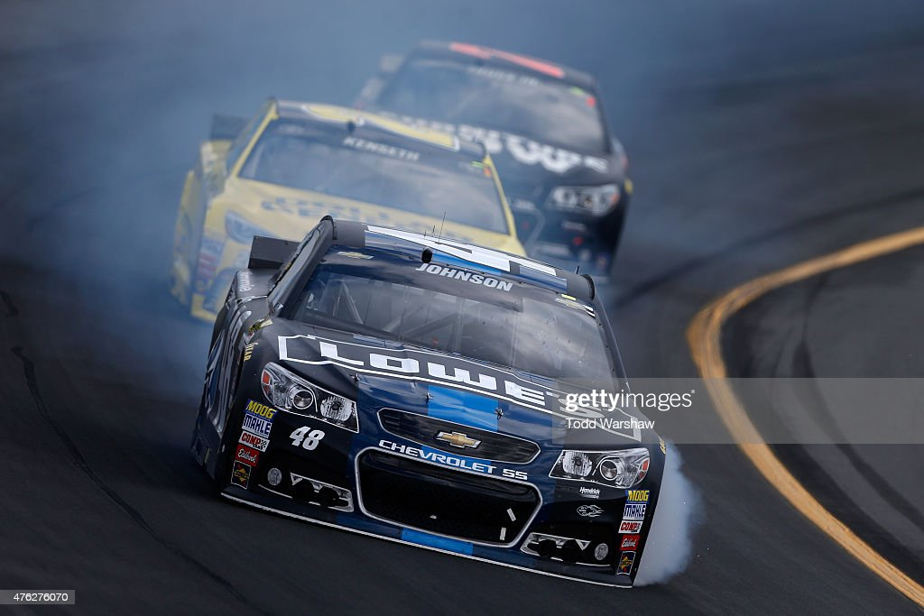 Smoke pours from the #48 Lowe's/<a gi-track='captionPersonalityLinkClicked' href=/galleries/search?phrase=Jimmie+Johnson+-+Piloto+da+Nascar&family=editorial&specificpeople=171519 ng-click='$event.stopPropagation()'>Jimmie Johnson</a> Foundation Chevrolet, driven by <a gi-track='captionPersonalityLinkClicked' href=/galleries/search?phrase=Jimmie+Johnson+-+Piloto+da+Nascar&family=editorial&specificpeople=171519 ng-click='$event.stopPropagation()'>Jimmie Johnson</a>, during the NASCAR Sprint Cup Series Axalta 'We Paint Winners' 400 at Pocono Raceway on June 7, 2015 in Long Pond, Pennsylvania.
