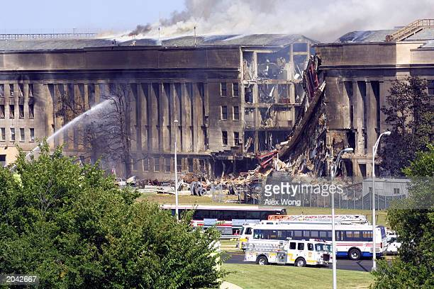 Smoke pours from the Southwest Ering of the Pentagon building September 11 2001 in Arlington Virginia after a hijacked plane crashed into the...