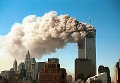 Smoke pours from the World Trade Center after it was hit by two hijacjked passenger planes September 11 2001 in New York City in an alleged terrorist...