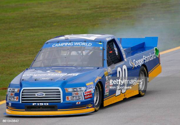 Smoke pours from under the truck of Chase Briscoe Cooper Standard Ford F150 during the Fred's 250 NASCAR Camping World truck race on October 14 at...
