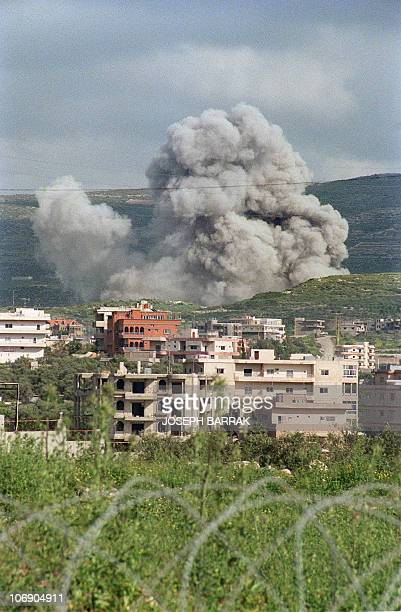 Smoke raises from the United Nations Interim Force in Lebanon compound after it was shelled by Israeli artillery in the southern town of Qana 18...