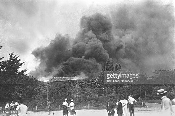 Smoke rise as Hibiya Matsumotoro Restaurant in a blaze after the Great Kanto Earthquake at Hibiya Park on September 1 1923 in Tokyo Japan The...