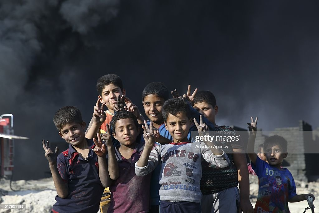 Smoke rise from oil wells, were set on fire by Daesh terrorists to limit coalition forces pilots' eyesight and to make the wells out o service following Iraqi army's retaking of Al Qayyarah town from Daesh during the operation to retake Iraq's Mosul from Daesh, in Mosul, Iraq on October 25, 2016. Black smoke affects human life in town badly.
