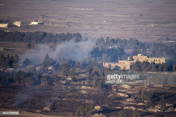 Smoke rise from the Syrian village of Quneitra as seen from the Israelioccupied Golan Heights as a result of fighting between forces loyal to Syrian...