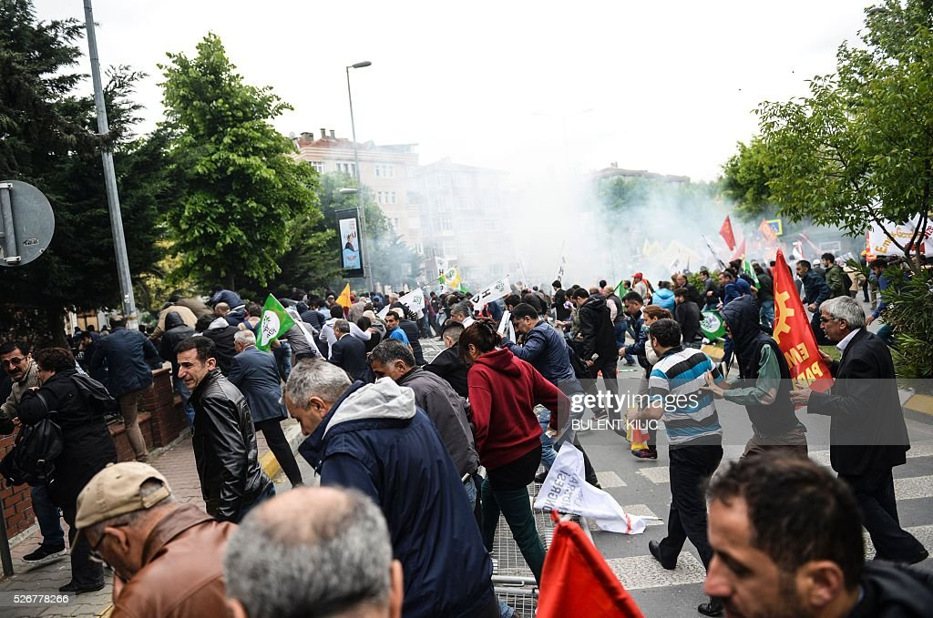 Smoke rises above as anti-riot police attempt to disperse protesters at a May Day rally in Bakirkoy, a district of Istanbul, on May 1, 2016. Turkish labour activists and leftists marked the annual May Day holiday, with thousands of security deployed and bracing for trouble after the authorities refused to allow protests in central Taksim Square. / AFP / BULENT