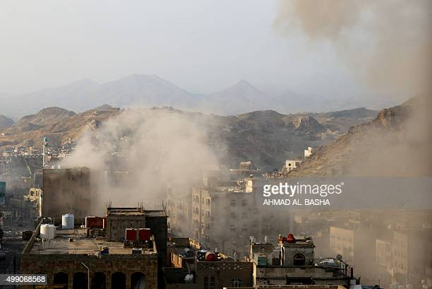 Smoke rises above buildings on the outskirts of Yemen's third city of Taez during clashes between fighters loyal to Yemeni President Abedrabbo...