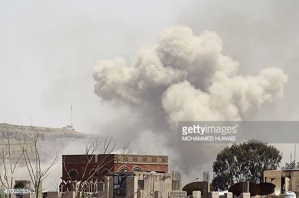 Smoke rises above the Alhva camp east of the Yemeni capital Sanaa on April 17 following an alleged air strike by the Saudiled alliance on Shiite...
