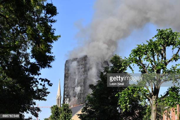 Smoke rises after a huge fire engulfed the 24 storey residential Grenfell Tower block in Latimer Road West London in the early hours of this morning...