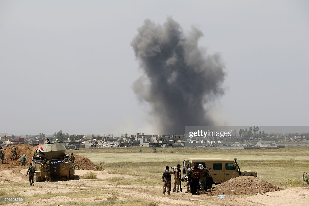 Smoke rises after a joint operation carried out by Peshmerga forces and Shiite Hasdi Sabi forces to rescue Turkmen Besir Village from Daesh in Iraq on April 30, 2016. Coalition forces support the operation with warcrafts.
