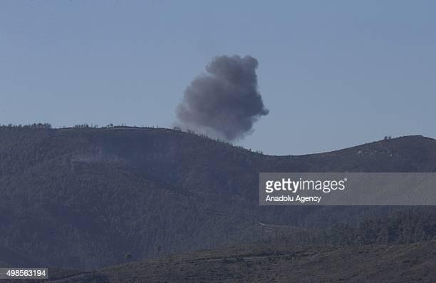 Smoke rises after a Russian warplane crashed in Syria's northwestern Turkmen town of Bayirbucak near Turkeys border on November 24 2015