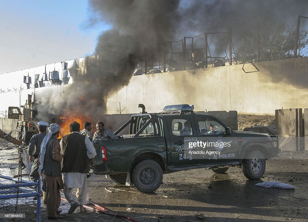 Smoke rises after a suicide bomber driving a car targeted US military convoy in Helmand Afghanistan on November 15 2015 At least 1 civilian is killed...