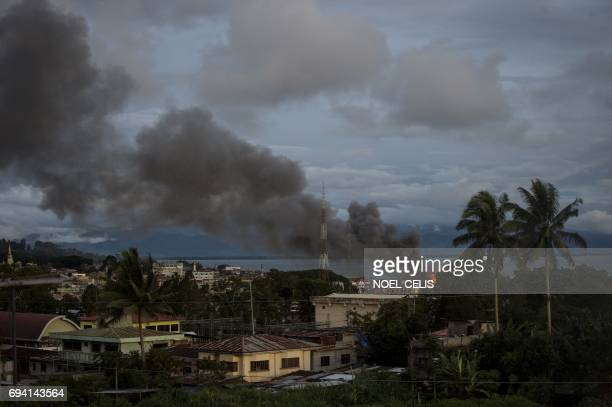 Smoke rises after aerial bombings by Philippine Air Force planes on Islamist militant positions in Marawi on the southern Philippine island of...