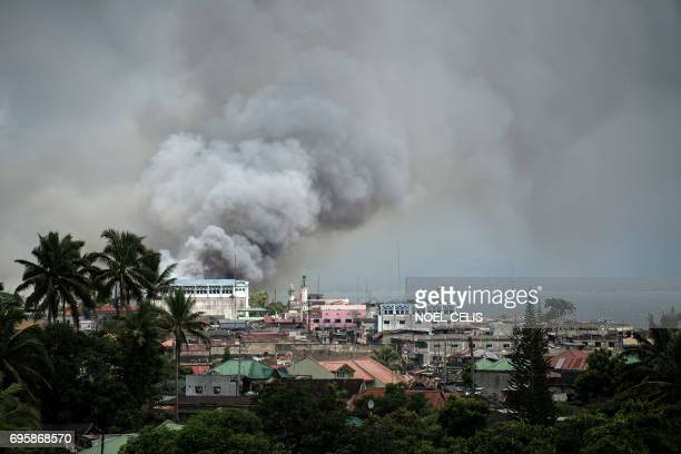 Smoke rises after aerial bombings by Philippine Air Force planes on Islamist militant positions in Marawi on the southern island of Mindanao on June...