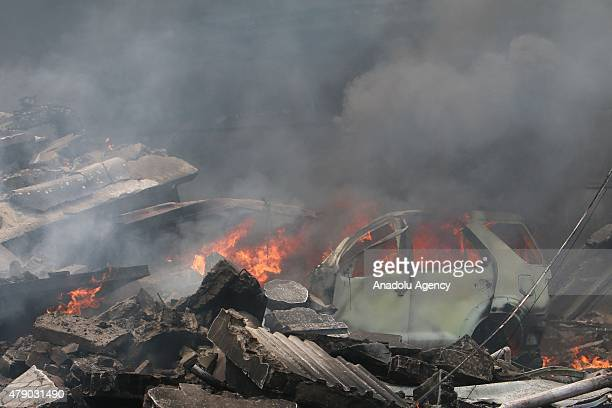Smoke rises after an air forceowned aircraft crashed in Medan North Sumatra Indonesia on June 30 2015 An Indonesian air force cargo plane crashed...
