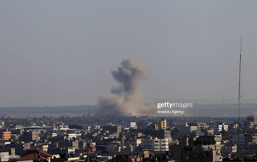 Smoke rises after an airstrike of Israeli forces upon the claim of launching rockets from Gaza to Israel, in Gaza city, Gaza on 20 August, 2014.