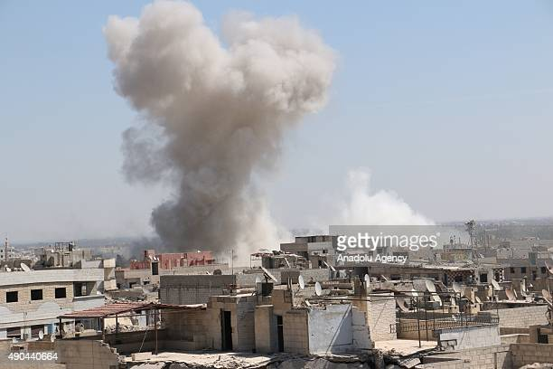 Smoke rises after an airstrike staged by Syrian regime forces to the opposition residential areas in Duma district in the Eastern Ghouta area of...