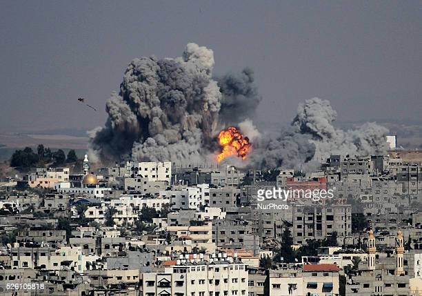 Smoke rises after an attack of Israeli aircraft in the east of Gaza City on July 29 2014 The home of Hamas Gaza political leader Ismail Haniyeh was...